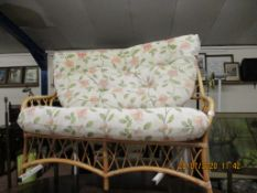 TWO-SEATER CANE CONSERVATORY SOFA, WIDTH APPROX 130CM