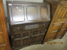 REPRODUCTION PANELLED FALL FRONT BUREAU WITH FITTED INTERIOR AND DECORATIVE CARVING, WIDTH APPROX