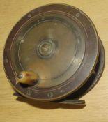 Vintage brass fishing reel, 11cm diam