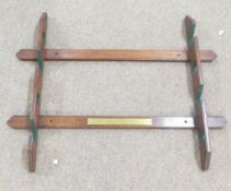Vintage wall mounted wooden gun rack for four guns, presented by Graham, Graham & Co, Pheasant