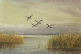 Roland Green (1896-1972), Ducks in Flight, pair of watercolours, both signed, 17 x 26cm