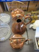 TWO COPPER KETTLES, TOGETHER WITH A SIMILAR WATER JUG, LARGER KETTLE HEIGHT APPOX 35CM