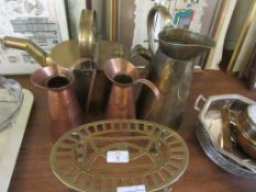 VARIOUS METAL WARE COMPRISING TRIVET, THREE WATER JUGS AND A WATER CAN