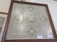 FRAMED DECORATIVE NEEDLEPOINT, GEOMETRIC PATTERN SURROUNDING A CENTRAL PANEL DEPICTING A