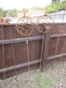 PAIR OF METAL GARDEN ORNAMENTS FORMED AS BALLS ON STICKS HEIGHT APPROX 150CM