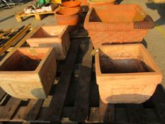 FOUR VARIOUS MOULDED SQUARE TERRACOTTA PLANTERS LARGEST APPROX 47CMSQ