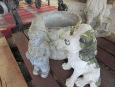 CIRCULAR PLANTER TOGETHER WITH A RESIN FIGURE OF A DOG AND A SMALL COMPOSITION OF A FAT POLICEMAN