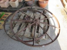 TWO VERY LARGE VINTAGE IRON WHEELS ONE NAMED FOR NICHOLSONS NEWARK NUMBERED 925X PROBABLY FROM