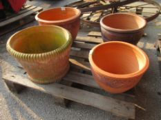 FOUR VARIOUS CIRCULAR TERRACOTTA PLANTERS THE LARGEST APPROX 45CM DIAMETER