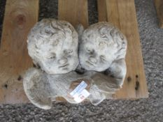 COMPOSITION GARDEN WALL PLAQUE DEPICTING TWO CHERUBS WIDTH APPROX 26CM