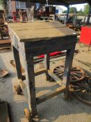 INTERESTING VINTAGE WOODEN CLARKS DESK MOUNTED ON FOUR CAST WHEELS PURPORTED TO HAVE BEEN REMOVED
