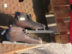 PAIR OF VINTAGE ICE SKATES