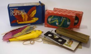 1950s/1960s Russian flying bird toy in original box with instructions, together with two pinball