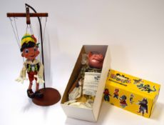 Vintage boxed Pelham puppet of a pig together with a further puppet on wooden and metal display