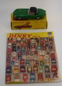 1960s Dinky Jaguar E-type model no 120, in original box (over-painted) and a Dinky Toys catalogue of