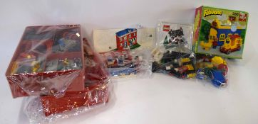 Quantity of vintage Lego to include two trays of assorted bricks and pieces, Lego Weetabix house set