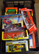 Box containing mainly Corgi boxed model cars together with Burago examples etc, all in original