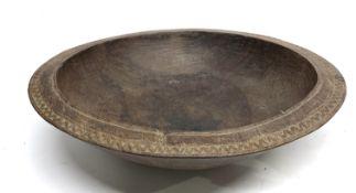 Vintage African handmade and carved hardwood circular bowl, 39.5cm diam