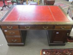Late 19th/early 20th century mahogany partner~s desk with gilt tooled red inset, the two pedestals