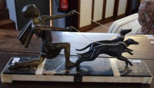 Art deco period spelter group standing on a pedestal (losses and repaired throughout) 52cm wide