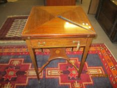 Edwardian mahogany inlaid |envelope| fold-top card table with single frieze drawer raised on