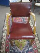 Oak carver chair red upholstered back and seat, the four plain supports joined by an H stretcher