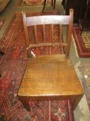 Oak solid seat side chair circa early 19th century