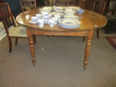 Large oak drop leaf dining table raised on ring turned supports with casters, 157cm wide