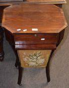 Late 19th century mahogany sewing table of octagonal form, fitted drawer over bag on swept