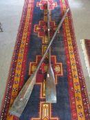 Pair of vintage varnished oars, 2.3m long
