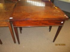 Early 19th century mahogany fold-top tea table with plain frieze and tapering square supports,