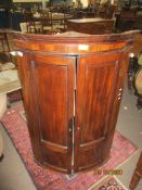 18th century mahogany bow fronted wall mounting corner cupboard, 79cm wide