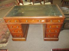 Victorian mahogany twin-pedestal desk, three frieze drawers over two pedestals, each fitted with