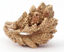 9ct gold designer ring, a textured foliate design, size J, 9.7gms