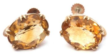 Pair of citrine set earrings, the oval faceted citrine multi-claw set in yellow metal basket