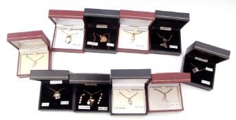 Ten boxed white metal (sterling) modern pendants to include amethyst, cubic zirconia examples