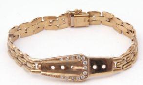 9Kt stamped modern bracelet, an articulated brick-link design with a paste set buckle, g/w 15gms