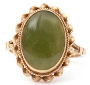 Late 20th century 9ct gold and jade ring, the oval shaped jade panel bezel set in a rope twist