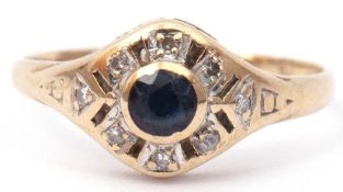 9ct gold, sapphire and diamond ring centring a bezel set round faceted sapphire surrounded by