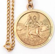 9ct gold large circular St Christopher, 32mm diam, London 1972, suspended from an oval link chain