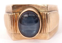 585 stamped haematite gent's ring, the central oval cut haematite in rub-over setting between