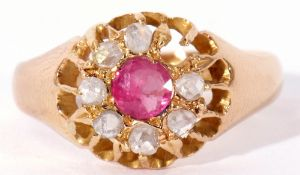 Early 20th century 18ct gold ruby and diamond cluster ring, the circular faceted cut ruby within a