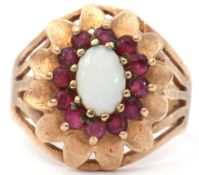 9ct gold opal and ruby set cluster ring, a design featuring an oval cabochon opal raised within a