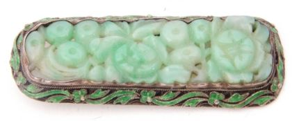 Chinese carved jade and enamel brooch, carved with a floral panel and framed in an enamel