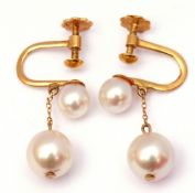 Pair of 18ct stamped pearl drop earrings featuring two graduated natural pearls, the larger drop 6mm
