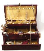 Brown leatherette folding jewel box to include various costume items, rings, brooches, necklaces,
