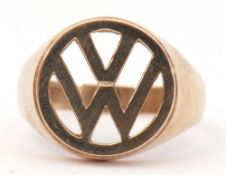 9ct gold ring, the pierced panel with the VW emblem, plain polished overall, size T, 5.1gms