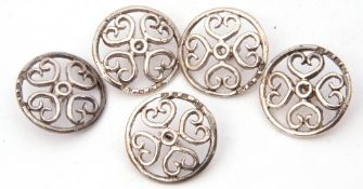 Mixed Lot: five Victorian silver buttons of shield shape centring a small pierced circle joining