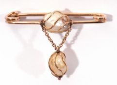 Baroque pearl pin brooch centring a wire work set baroque pearl with similar set dropper below,