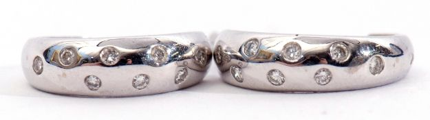 Pair of 18ct stamped half hoop earrings, each flush set with 8 round brilliant diamonds to post